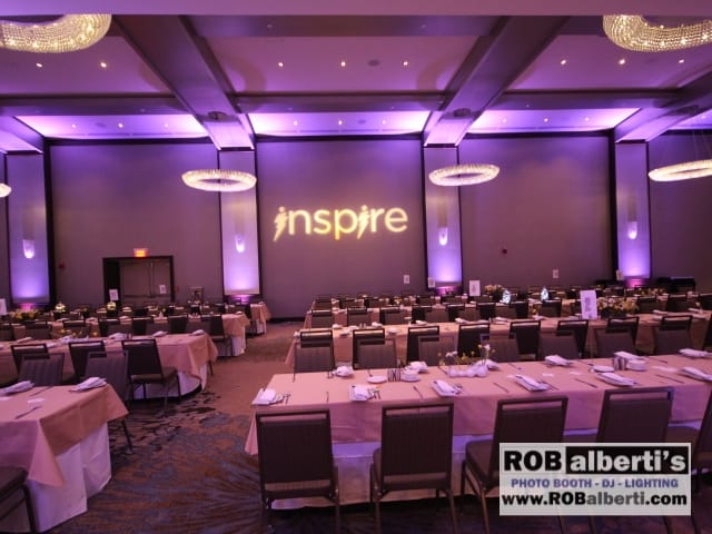 Purple up-lighting with logo projection on wall